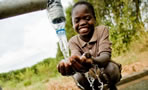 child getting clean water
